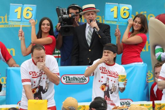 Joey Chestnut, left, and Matt Stonie compete in Nathan's Famous Fourth of July International Hot Dog Eating Contest men's competition Saturday July 4, 2015 in the Coney Island section in the Brooklyn borough of New York. Stonie came in first eating 62 hot dogs and buns in 10 minutes. Chestnut came in second eating 60 hot dogs and buns in 10 minutes. (AP Photo/Tina Fineberg)
